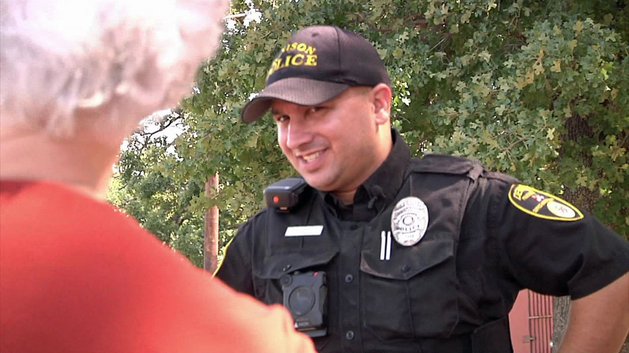 Denison police Officer Donald Hash chats with a woman on his beat. (KTEN)
