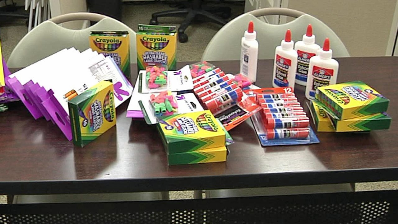 Some of the school supplies collected by Ebby Halliday Realtors in Sherman. (KTEN)