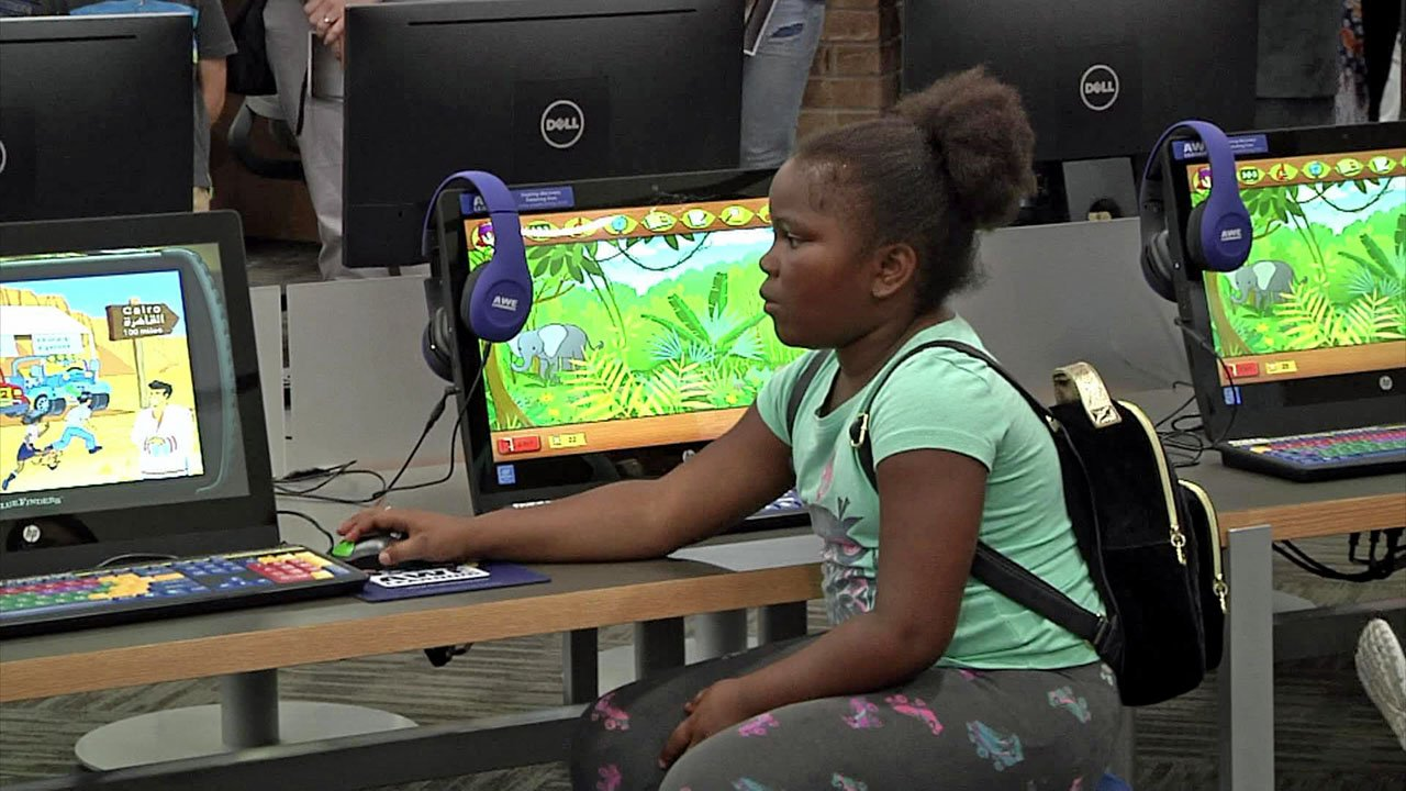 Upgrades to the Sherman Public Library include computers for kids. (KTEN)