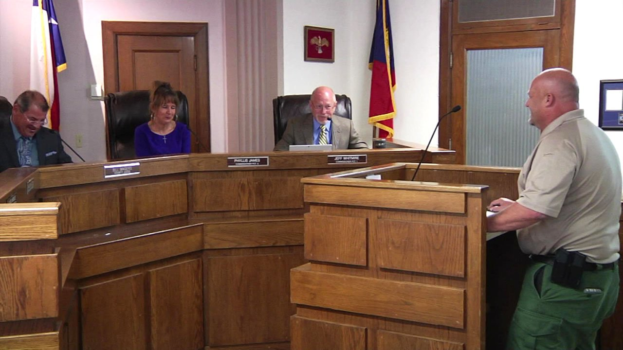 Grayson County Commissioners discuss a proposed donation of weapons to the sheriff's office on August 14, 2018. (KTEN)