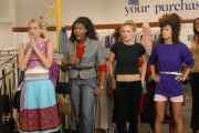 Natasha (in all black) and other contestants at thrift store. Photo courtesy www.cwtv.com