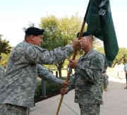 Maj. Gen. John T. Furlow, Texas Army National Guard commander, passes the guidon to the new commander of C Company, 5th Battalion, 19th Special Forces Group, Texas Army National Guard. (Texas Military Forces photo by Chief Master Sgt. Gonda Moncada)