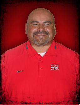 Coach J.D. Marinez
