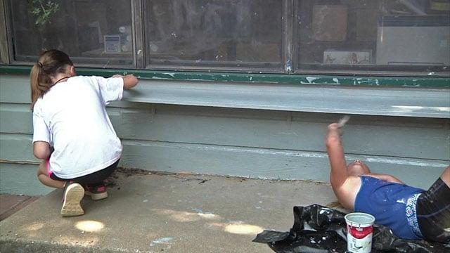 SAY volunteers painting