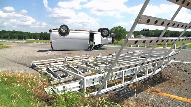 Van flips on FM 120 in Denison