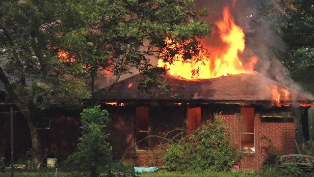 Flames consume residence in Bells
