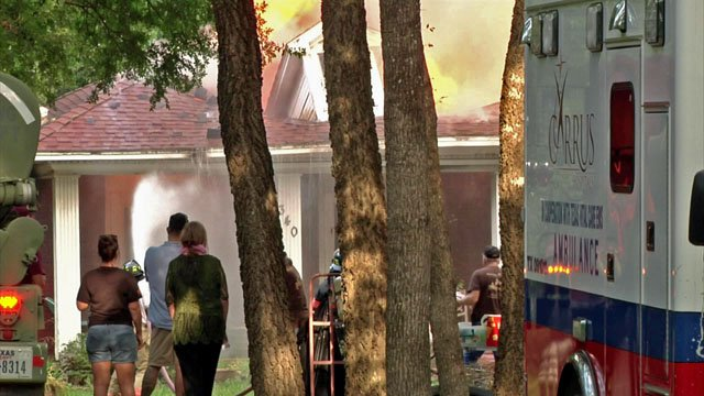 Neighbors watch as house burns in Bells