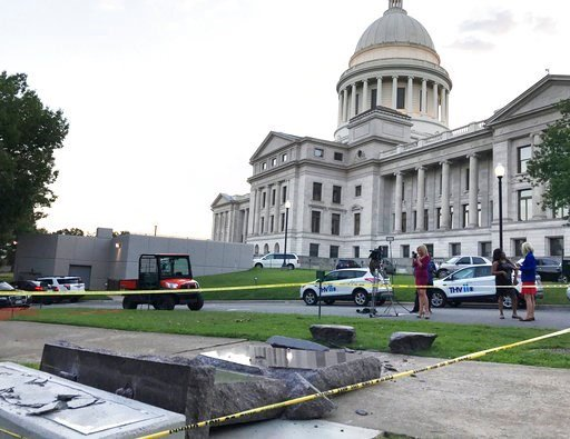 The new Ten Commandments monument outside the state Capitol in Little Rock, Ark., is blocked off Wednesday morning, June 28, 2017, after someone crashed into it with a vehicle. (AP Photo/Jill Zeman Bleed).