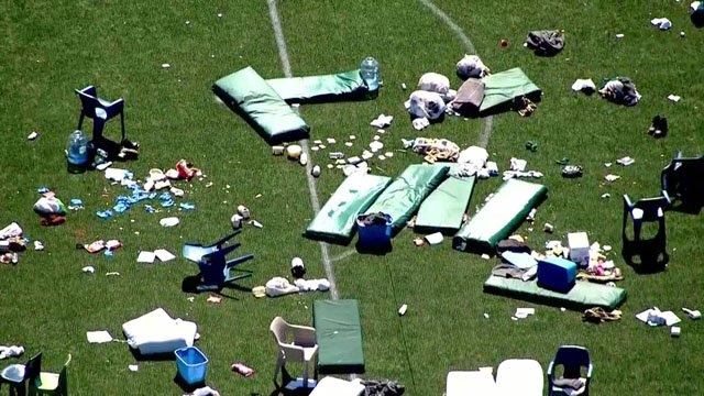 Debris litters athletic field at Great Plains Correctional Facility.