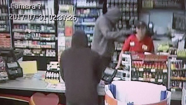 Two suspects are seen robbing a clerk at the Love's Country Store in Madill.