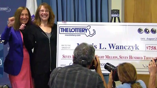 Mavis Wanczyk and her giant check