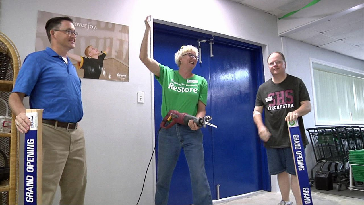 A board-sawing ceremony signaled the grand opening of Sherman's new Habitat for Humanity ReStore. (KTEN)