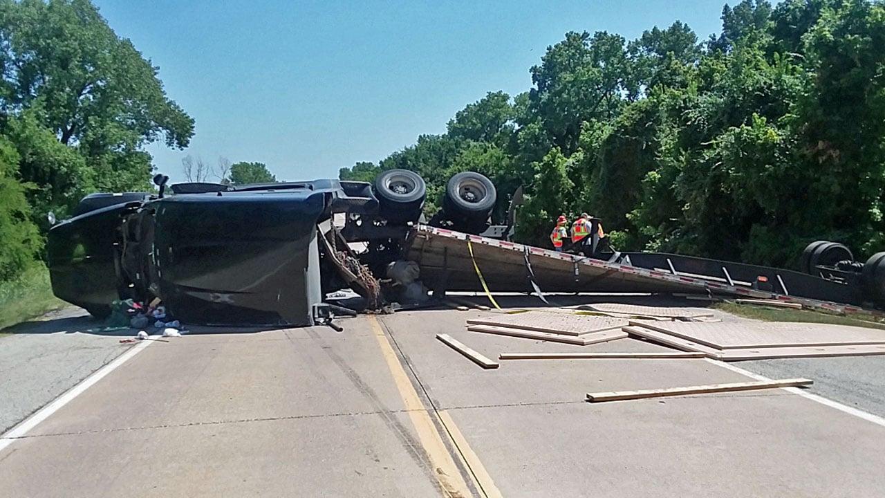 An overturned 18-wheeler blocked U.S. 377 just north of the Willis bridge on July 19, 2018. (KTEN)