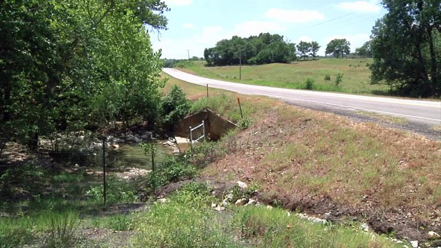 Brenda Carter was left for dead in this creek near Fittstown. (KTEN)