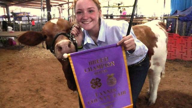 Braylee Cowan displays her latest prize at the Fannin County Fair. (KTEN)