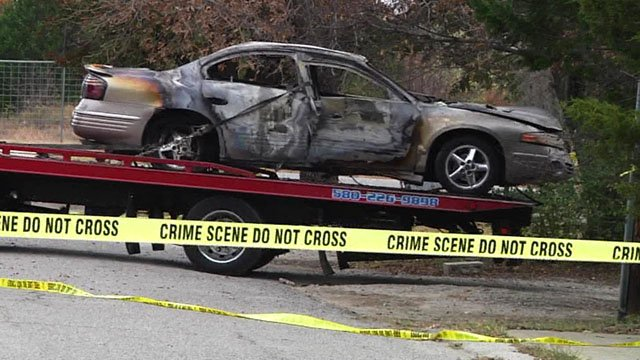 Two bodies were found inside this charred car in an Ardmore driveway in November 2017. (KTEN)