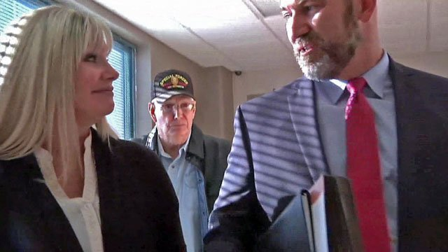 Shelley Jo Duncan, left, leaves a Johnston County courtroom on December 15, 2017. (KTEN)