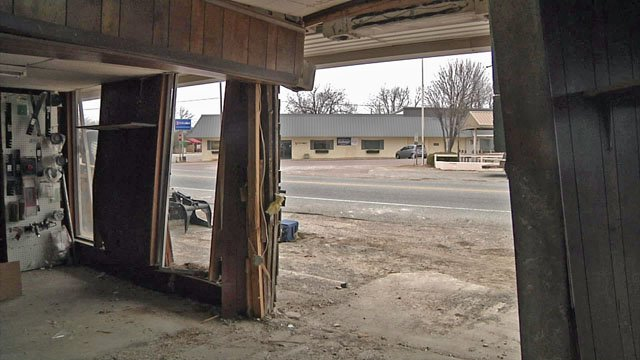 Colbert Hardware and Farm Supply was heavily damaged when a car crashed into the front of the store. (KTEN)