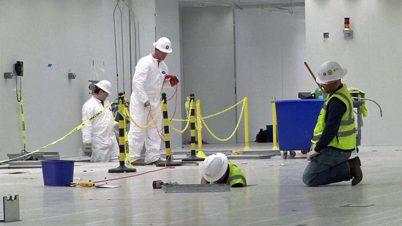 Workers remake the old MEMC facility to Finisar specifications. (KTEN)