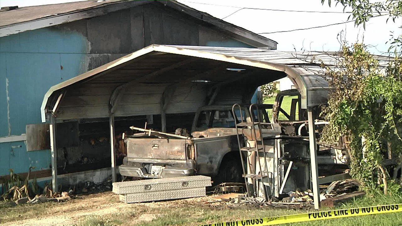 A pickup truck in a car port was charred in a fire on Christi Lane in Southmayd on May 15, 2018. (KTEN)