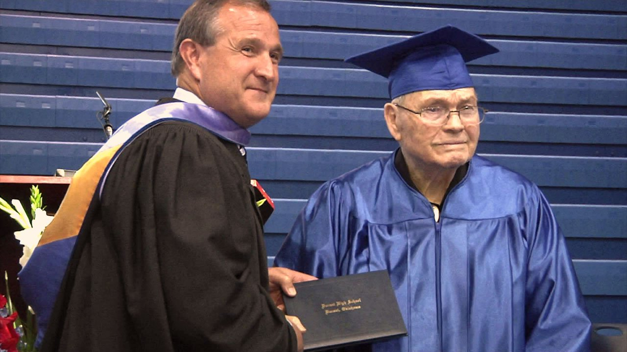 Talma Sadler accepts his long-overdue diploma at Durant High School. (KTEN)