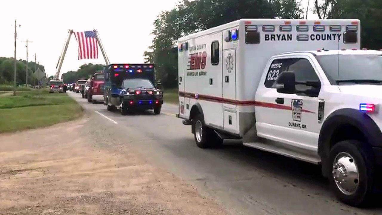 Emergency vehicles led a solemn procession following funeral services for Wapanucka Fire Chief Gary Reeder. (KTEN)