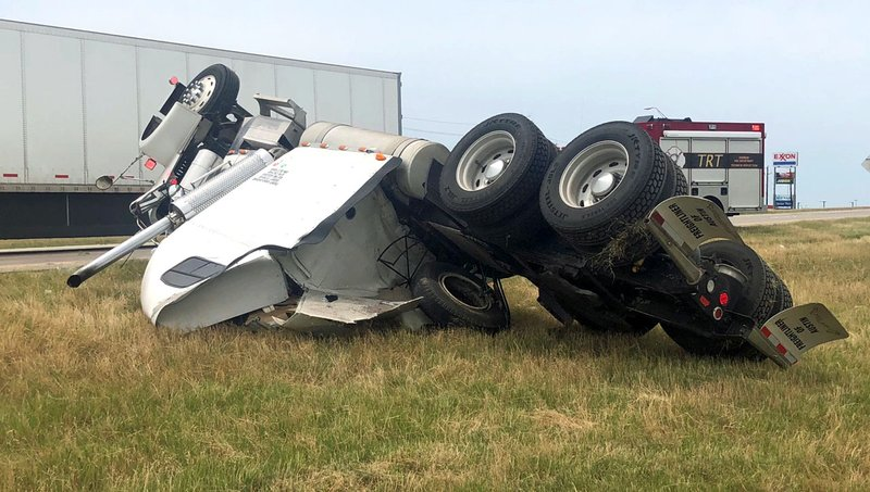 The driver was injured when this truck overturned in the median of U.S. 75 in Sherman on June 12, 2018. (KTEN)