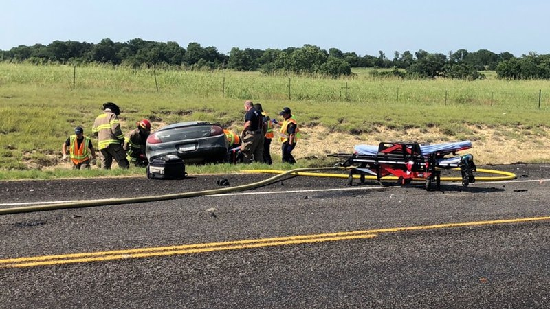 Emergency personnel work at the scene of a two-car crash near the intersection of  State Highway 84 and FM 91 in Denison on June 13, 2018. (KTEN)