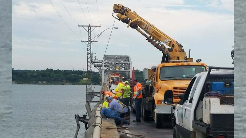 Heavy equipment is in place to help lift an 18-wheeler from the bottom of Lake Texoma. (KTEN)