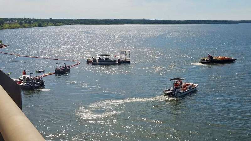 A flotilla of rescue boats worked to recover the wreckage of an 18-wheeler from the bottom of Lake Texoma on June 25, 2018. (KTEN)