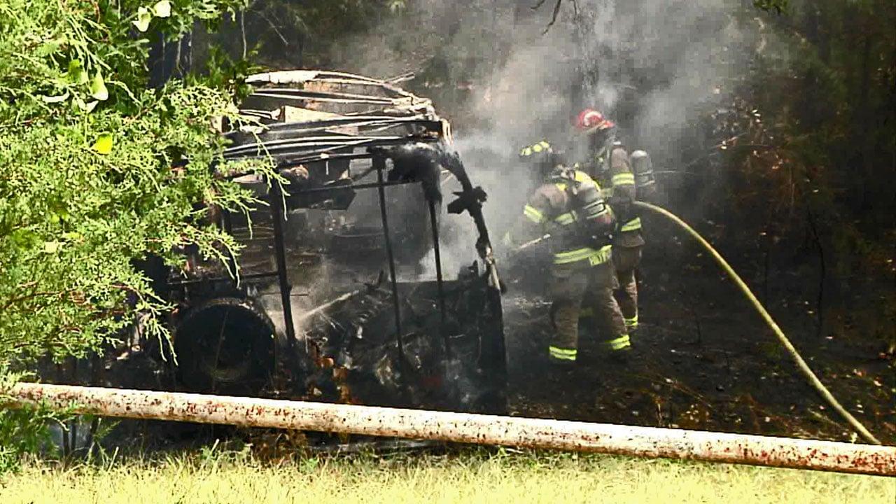 Firefighters extinguish a burning motor home along FM 84 in Denison on July 27, 2018. (KTEN)