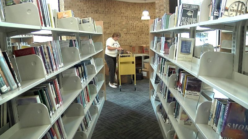 Sherman Public Library employees are getting ready for the facility's reopening on August 13, 2018. (KTEN)
