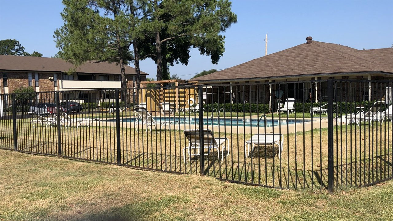Police said someone drowned at this pool at the Creekmore apartments in Denison on August 3, 2018. (KTEN)