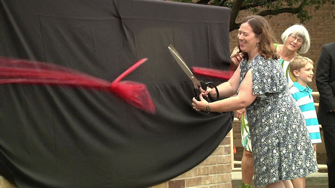Library Services Administrator Melissa Eason cuts the ribbon on the newly-renovated Sherman Public Library on August 8, 2018. (KTEN)
