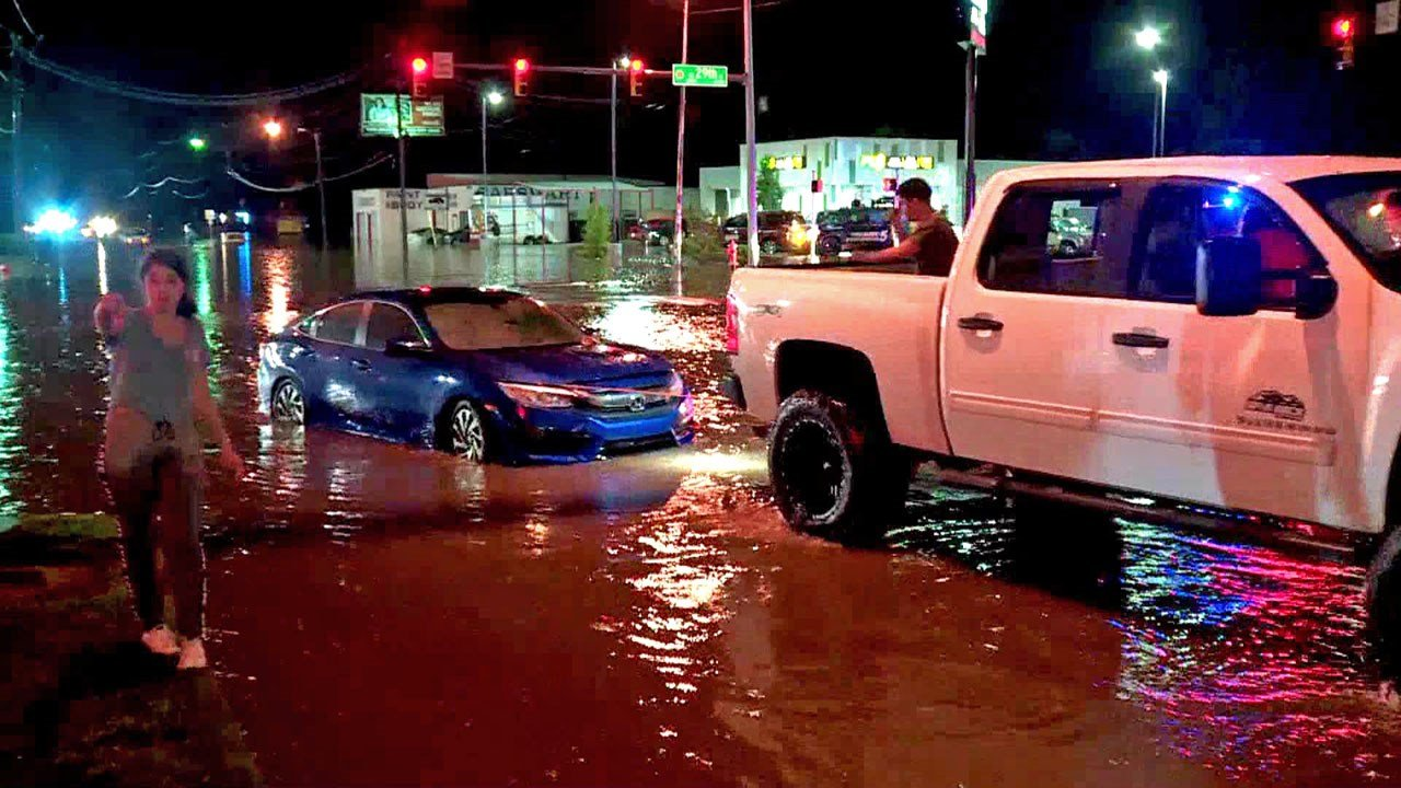 A car is pulled from flash flooding in Oklahoma City on August 14, 2018. (KFOR via NBC News)