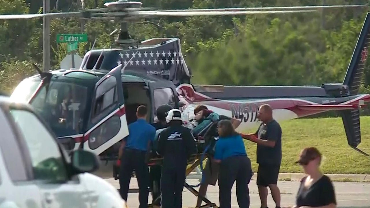 A student who was stabbed at Luther High School is moved to a medical evacuation helicopter on August 16, 2018. (KTEN)