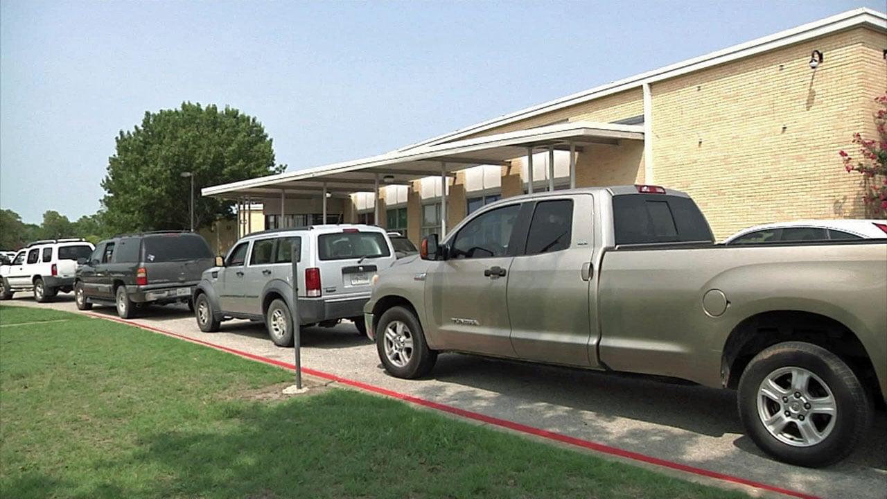 Parents wait in line outside Crutchfield Elementary School in Sherman. (KTEN)