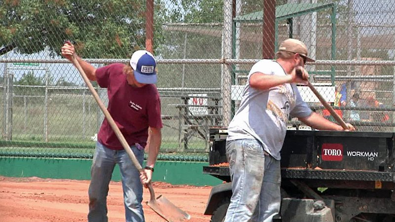 Workers renovate the infield at the Ardmore Regional Park softball complex. (KTEN)