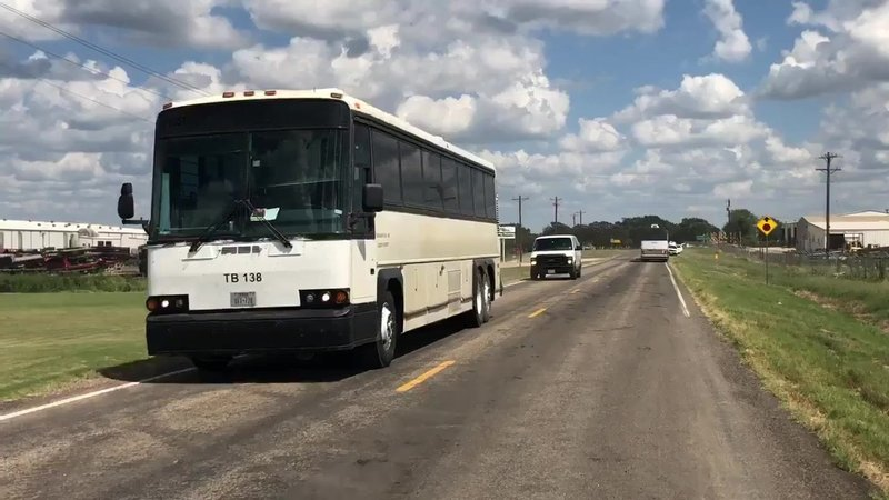 ICE used buses to remove alleged undocumented immigrants from the Load Trail manufacturing plant on August 28, 2018. (KTEN)