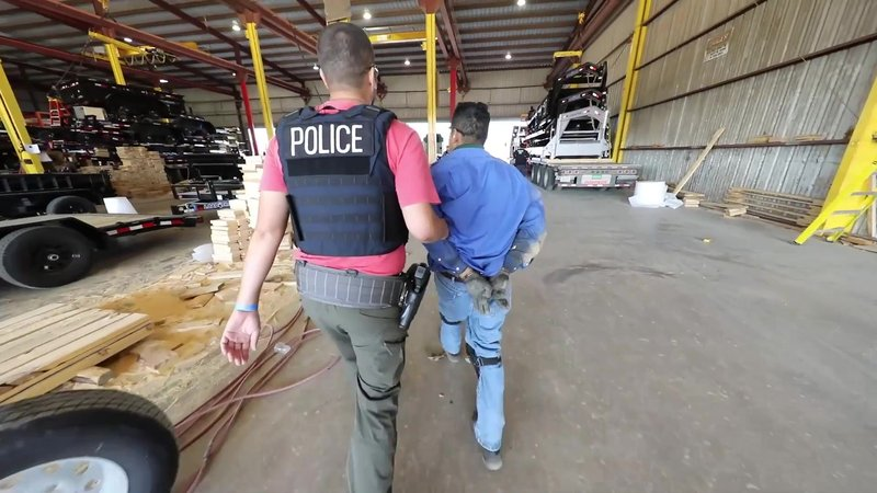 An employee at Load Trail is taken into custody by federal agents on August 28, 2018. (ICE photo)