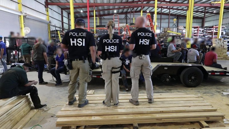 Federal agents supervise the custody of dozens of employees at the Load Trial plant on August 28, 2018. (ICE photo)