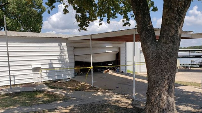 A shooting suspect's vehicle crashed into this storage locker at Marina del Rey in Kingston, Oklahoma, on September 2, 2018. (Courtesy)