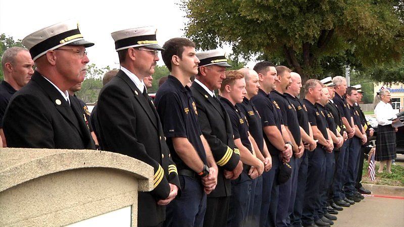 Police and firefighters attend a 9/11 remembrance ceremony in Sherman. (KTEN)