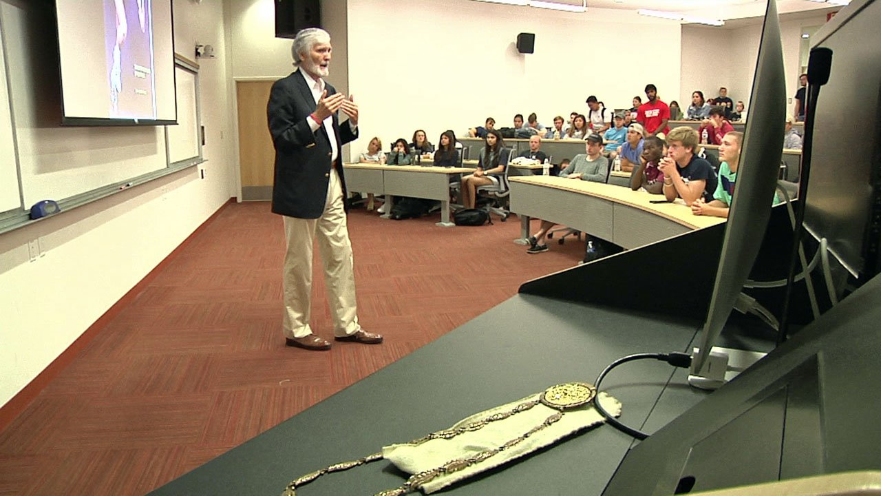 Olympic athlete Earl Young keeps his gold medal nearby as he speaks with Austin College students. (KTEN)