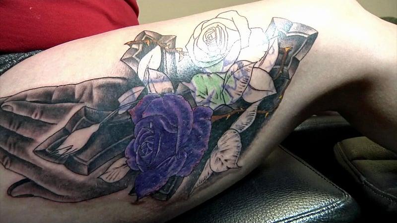 Jennifer Carter's new tattoo masks the unwanted original ink. (KTEN)