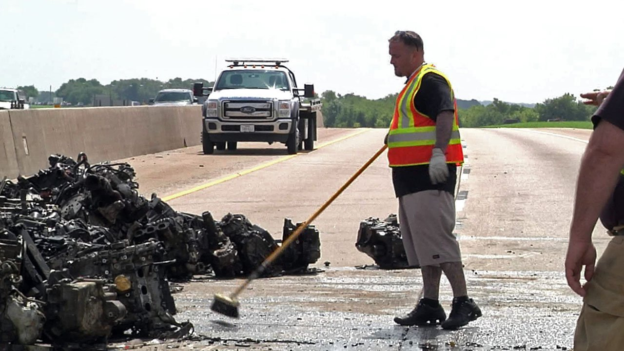 Work was underway to clean up U.S. 75 after a truck spilled engines and oil on the highway near Howe on September 13, 2018. (KTEN)
