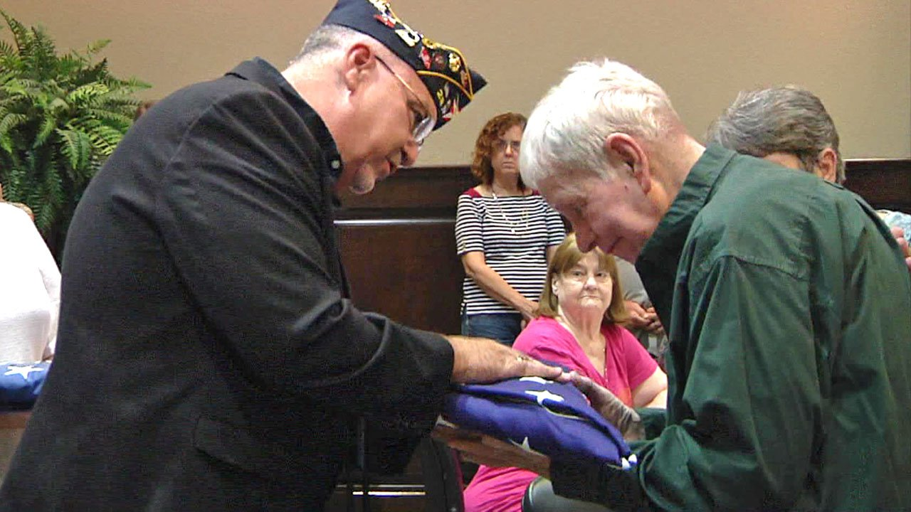 Retired Airman First Class James Blakey, right, was presented with two American flags at a ceremony on his 77th birthday on September 16, 2018. (KTEN)