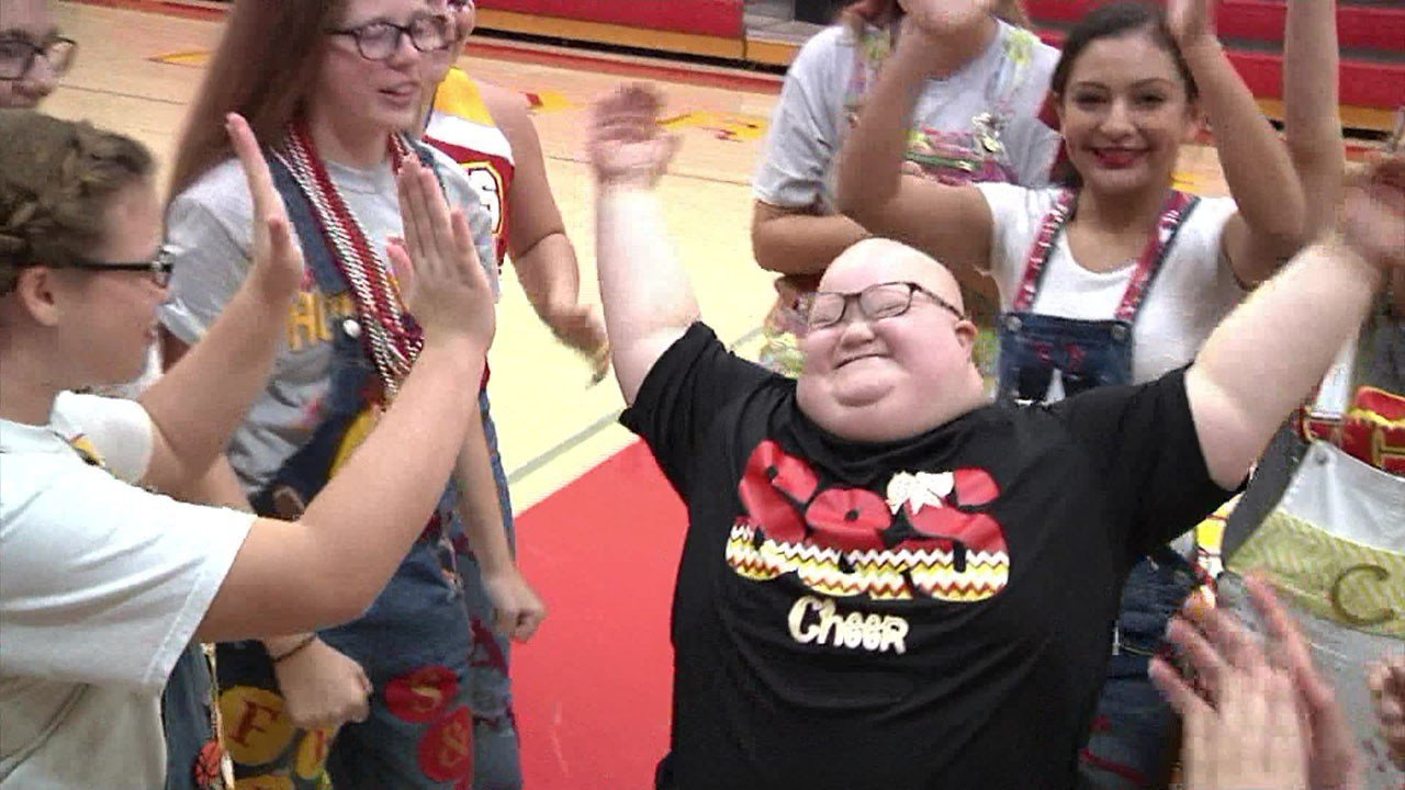 S&S High School student Emily Petty is surrounded by the love of the schools' Cheer Team. (KTEN)
