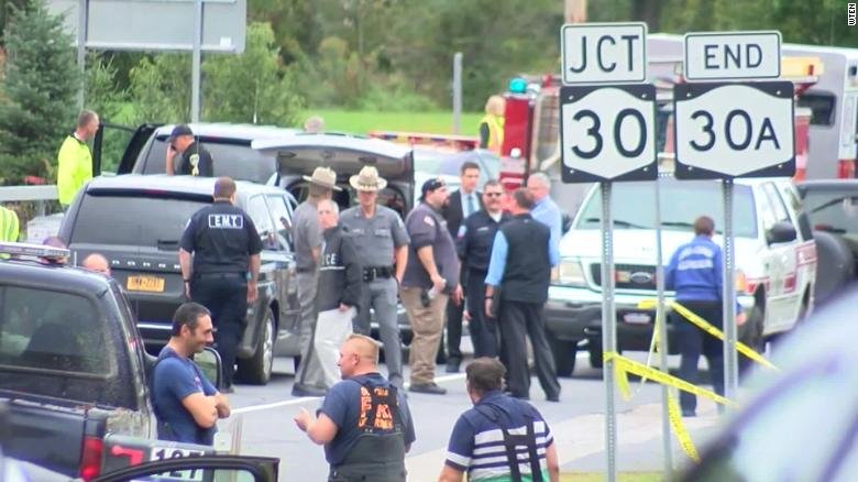 A witness described hearing a loud bang and screaming after a limousine struck a parked vehicle near Schoharie, New York, leaving 20 people dead. (WTEN via CNN)