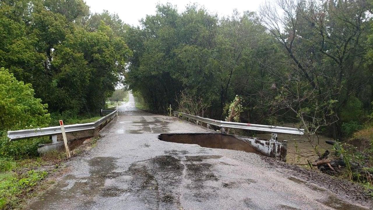 The Cedar Road bridge over Cedar Creek was washed out by flooding. (KTEN)